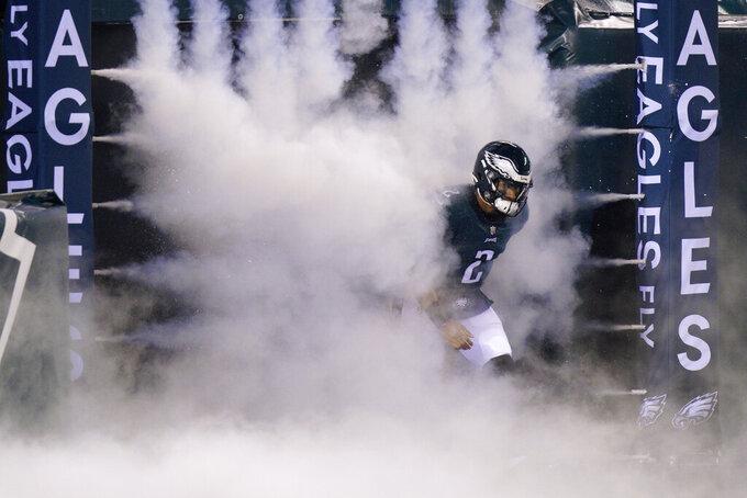 Philadelphia Eagles' Jalen Hurts runs onto the field before an NFL football game against the Washington Football Team, Sunday, Jan. 3, 2021, in Philadelphia. (AP Photo/Chris Szagola)