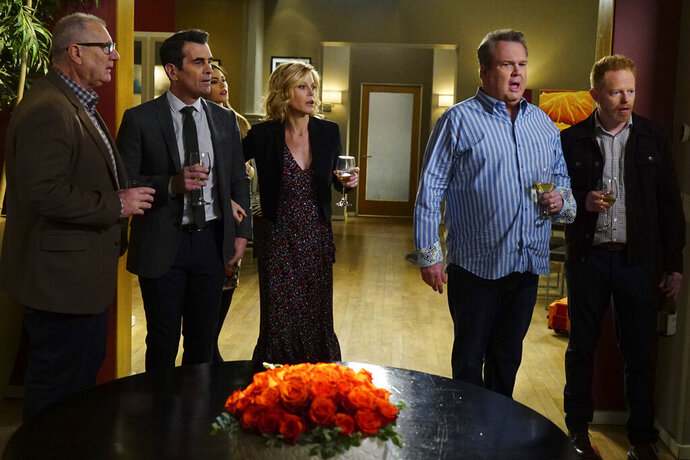 This image released by ABC shows, from left, Ed O'Neill, Ty Burrell, Sofia Vergara, obscured, Julie Bowen, Eric Stonestreet and Jesse Tyler Ferguson in a scene from