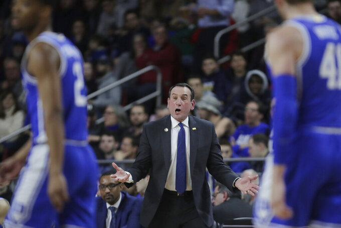 Duke head coach Mike Krzyzewski calls to his players during the first half of an NCAA college basketball game against Boston College in Boston, Tuesday, Feb. 4, 2020. (AP Photo/Charles Krupa)