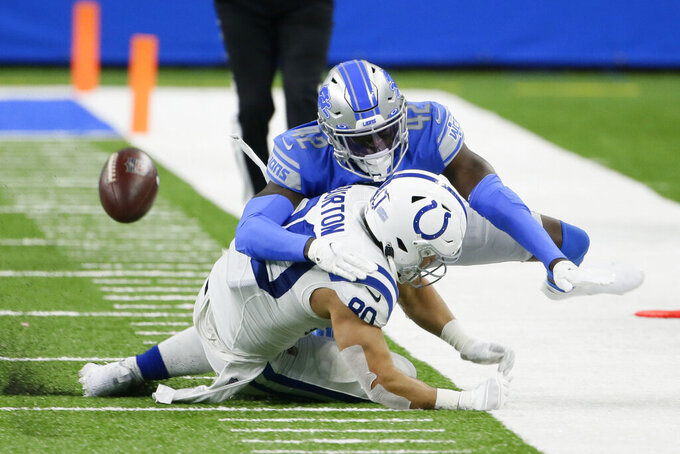 Detroit Lions safety Jayron Kearse deflects a pass intended for Indianapolis Colts tight end Trey Burton (80) during the second half of an NFL football game, Sunday, Nov. 1, 2020, in Detroit. (AP Photo/Duane Burleson)