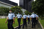 Police officers patrol outside the Central Government Offices in Hong Kong, Friday, May 22, 2020. Hong Kong's pro-democracy lawmakers have sharply criticized China's move to take over long-stalled efforts to enact national security legislation in the semi-autonomous territory. They say it goes against the