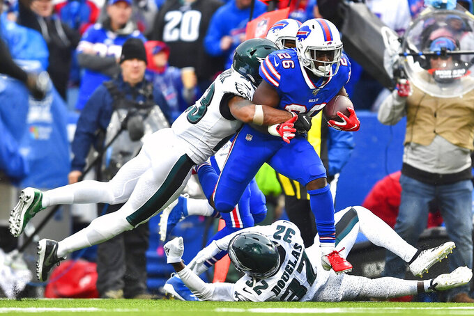 Buffalo Bills' Devin Singletary (26), center, breaks tackles to score a touchdown during the second half of an NFL football game against the Philadelphia Eagles, Sunday, Oct. 27, 2019, in Orchard Park, N.Y. (AP Photo/Adrian Kraus)