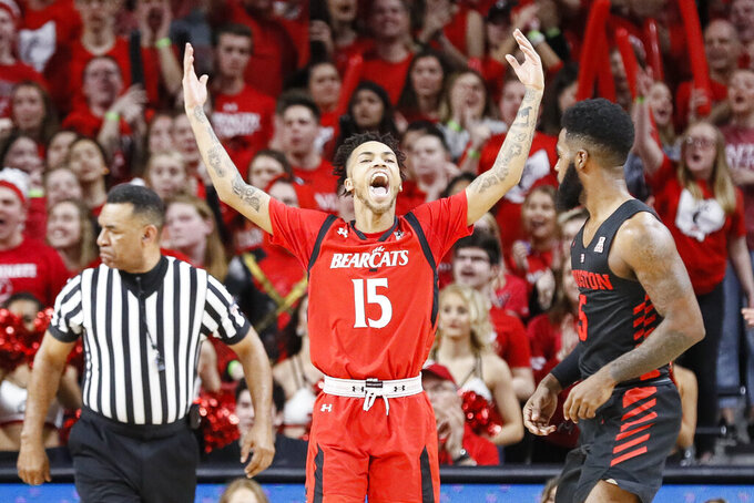 Cincinnati's Cane Broome (15) reacts alongside Houston's Corey Davis Jr., right, in the first half of an NCAA college basketball game, Sunday, March 10, 2019, in Cincinnati. (AP Photo/John Minchillo)