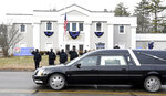 FILE - In this Thursday, Jan. 14, 2021. file photo, Norton, Mass. police salute as a hearse carrying colleague Det. Sgt. Stephen Desfosses briefly stops in front of the police station. Desfosses, 52, a local police officer for 32 years, died of the coronavirus Wednesday in Boston with members of his family by his side, Police Chief Brian Clark said in a statement. Coronavirus deaths are rising in nearly two-thirds of American states as a winter surge pushes the overall toll toward 400,000 amid warnings that a new, highly contagious variant is taking hold. (Mark Stockwell/The Sun Chronicle via AP)