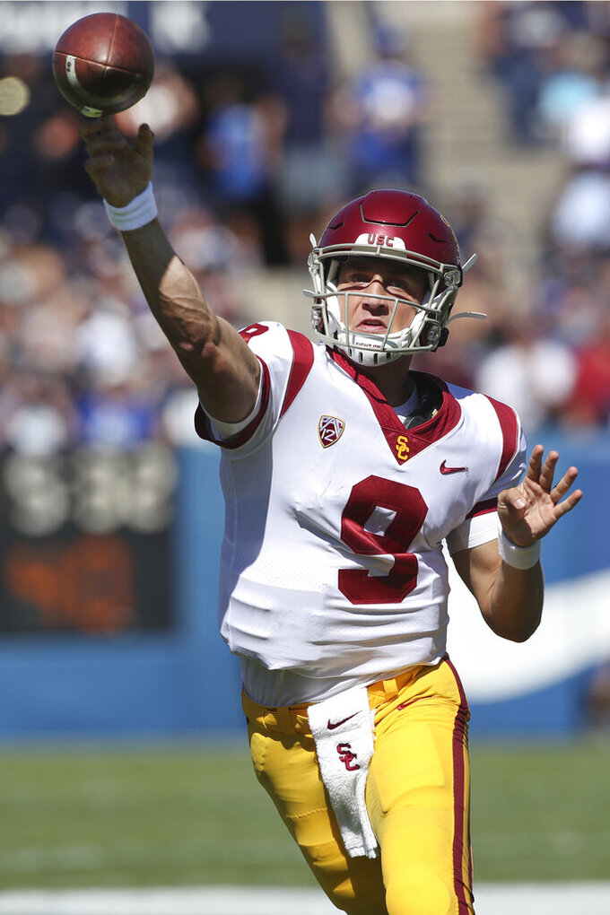 Southern California quarterback Kedon Slovis (9) throws the ball in the first half of an NCAA college football game against BYU, Saturday, Sept. 14, 2019, in Provo, Utah. (AP Photo/George Frey)