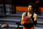 Oklahoma State's Cade Cunningham warms up before the NCAA college basketball game against Texas Christian in Stillwater, Okla., Wednesday, Dec. 16, 2020. (AP Photo/Mitch Alcala)