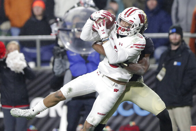 Wisconsin wide receiver Danny Davis III (6) makes a catch for a touchdown in front of Purdue cornerback Antonio Blackmon (14) during the second half of an NCAA college football game in West Lafayette, Ind., Saturday, Nov. 17, 2018. Wisconsin defeated Purdue 47-44 in overtime. (AP Photo/Michael Conroy)