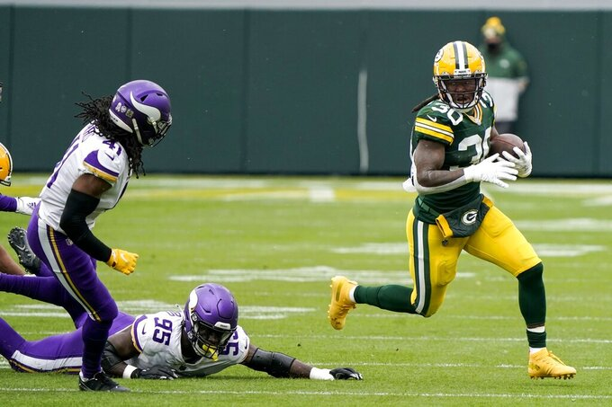 Green Bay Packers' Jamaal Williams runs during the first half of an NFL football game against the Minnesota Vikings Sunday, Nov. 1, 2020, in Green Bay, Wis. (AP Photo/Morry Gash)