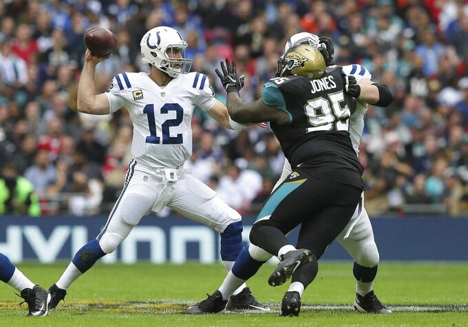 FILE - In this Oct. 2, 2016, file photo, Indianapolis Colts quarterback Andrew Luck (12) passes the ball as Jacksonville Jaguars defensive tackle Abry Jones (95) closes in during an NFL football game at Wembley Stadium in London, Sunday Oct. 2, 2016. Jones has made six trips to London in as many seasons. (AP Photo/Tim Ireland, File)