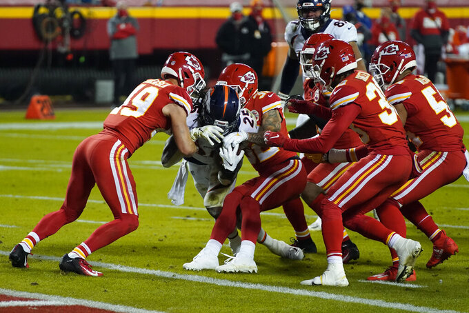 Kansas City Chiefs free safety Daniel Sorensen (49) helps keep Denver Broncos running back Melvin Gordon (25) out of the end zone in the first half of an NFL football game in Kansas City, Mo., Sunday, Dec. 6, 2020. (AP Photo/Jeff Roberson)