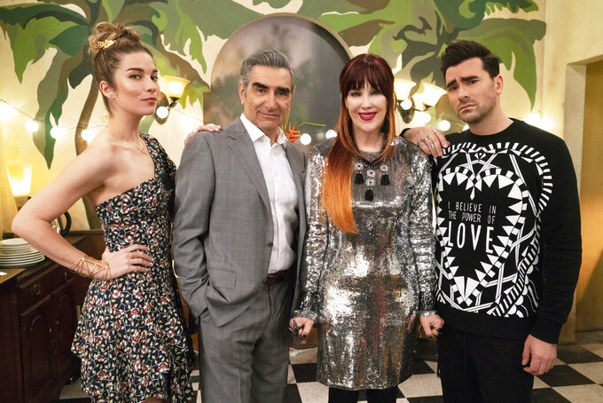 """This image released by Pop TV shows, from left, Annie Murphy, Eugene Levy, Catherine O'Hara and Dan Levy from the series """"Schitt's Creek.""""  Nominations for the Emmy Awards will be announced on Tuesday, July 28.(Pop TV via AP)"""