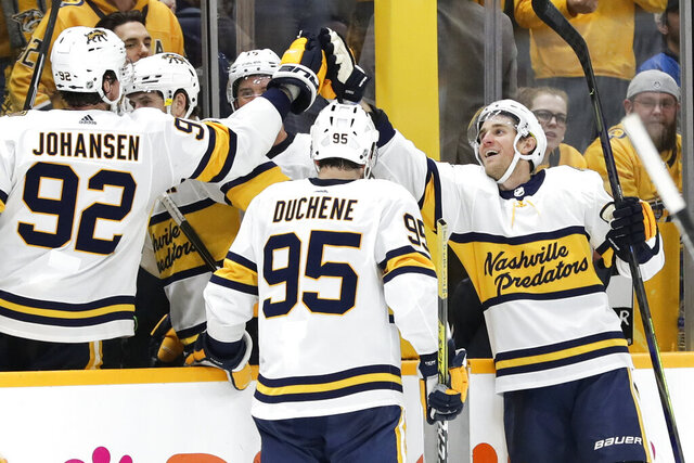 Nashville Predators center Kyle Turris, right, celebrates with Ryan Johansen (92) and Matt Duchene (95) after Turris scored against the St. Louis Blues during the third period of an NHL hockey game Sunday, Feb. 16, 2020, in Nashville, Tenn. The Predators won 2-1. (AP Photo/Mark Humphrey)