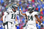 Philadelphia Eagles' Jordan Howard, right, celebrates his touchdown with quarterback Carson Wentz during the second half of an NFL football game against the Buffalo Bills, Sunday, Oct. 27, 2019, in Orchard Park, N.Y. (AP Photo/Adrian Kraus)