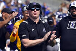 Northwestern head coach Pat Fitzgerald applauds after a touchdown was scored against Indiana State in the first half of an NCAA college football game in Evanston, Ill, Saturday, Sept.11, 2021. (AP Photo/Matt Marton