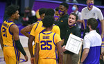 LSU coach Will Wade speaks with his players during a timeout in the team's NCAA college basketball game against Georgia on Wednesday, Jan. 6, 2021, in Baton Rouge, La. (Hilary Scheinuk/The Advocate via AP)