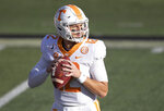 Tennessee quarterback J.T. Shrout (12) looks for a receiver during warmups before an NCAA college football game against Vanderbilt, Saturday, Dec. 12, 2020, in Nashville, Tenn. (AP Photo/Wade Payne)