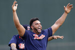 Minnesota Twins designated hitter Nelson Cruz (23) laughs with his teammates as they stretch during spring training baseball camp Sunday, Feb. 16, 2020, in Fort Myers, Fla. (AP Photo/John Bazemore)
