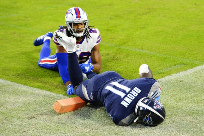 Tennessee Titans wide receiver A.J. Brown (11) hangs onto the ball after catching a touchdown pass as he was defended by Buffalo Bills cornerback Josh Norman (29) in the first half of an NFL football game Tuesday, Oct. 13, 2020, in Nashville, Tenn. (AP Photo/Mark Zaleski)