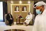 U.S. Secretary of State Mike Pompeo, left, meets with Qatar's Deputy Prime Minister and Minister of Foreign Affairs Mohammed bin Abdulrahman Al Thani, Saturday, Nov. 21, 2020, in Doha, Qatar. (AP Photo/Patrick Semansky, Pool)