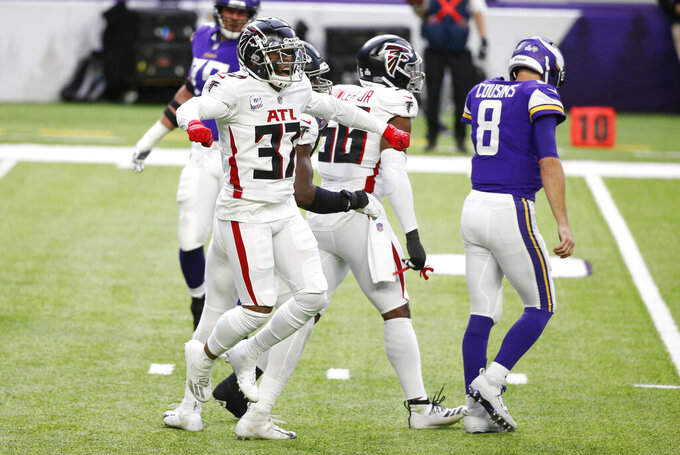 Atlanta Falcons safety Ricardo Allen celebrates in front of Minnesota Vikings quarterback Kirk Cousins (8) after a defensive stop during the first half of an NFL football game, Sunday, Oct. 18, 2020, in Minneapolis. (AP Photo/Bruce Kluckhohn)
