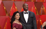 FILE - In this March 4, 2018, file photo, Vanessa Laine Bryant, left, and Kobe Bryant arrive at the Oscars at the Dolby Theatre in Los Angeles. Vanessa Bryant on Tuesday, Sept. 22, 2020, filed a lawsuit against the Los Angeles County sheriff claiming negligence, invasion of privacy and intentional infliction of emotional distress after deputies allegedly shared unauthorized photos of the crash that killed her husband, their 13-year-old daughter and seven others. (Photo by Richard Shotwell/Invision/AP, File)