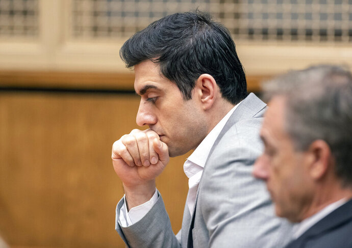Defendant Hossein Nayeri listens to the judges' instructions before the reading of the verdict in his trial, Friday, Aug. 16, 2019 in Newport Beach, Calif.  Nayeri, who previously escaped from jail and was on the run for a week was convicted Friday of kidnapping and torturing a marijuana dispensary owner who he mistakenly believed had buried large sums of money in the desert. (Paul Bersebach/The Orange County Register via AP)
