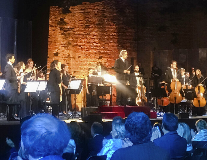 Italian Maestro Riccardo Muti, top center, prepares to direct a concert at the Ravenna Festival, in Ravenna, Northern Italy, Sunday, June 21, 2020. Riccardo Muti has sent a resounding message that live classical music has returned the Italian stage after the coronavirus lockdown with a full summer festival program in his adopted Ravenna. (AP Photo/Colleen Barry)