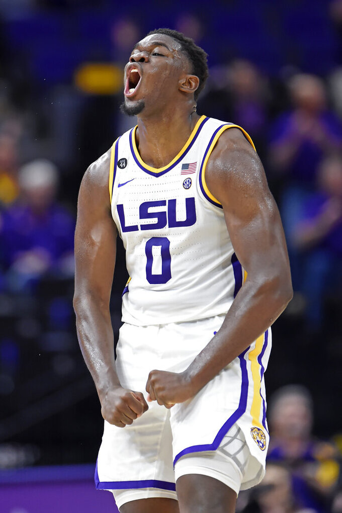 LSU forward Darius Days (0) celebrates making a crucial rebound and putback to score late in the second half of an NCAA college basketball game, Tuesday, Feb. 11, 2020, in Baton Rouge, La. LSU won 82-78. (AP Photo/Bill Feig)
