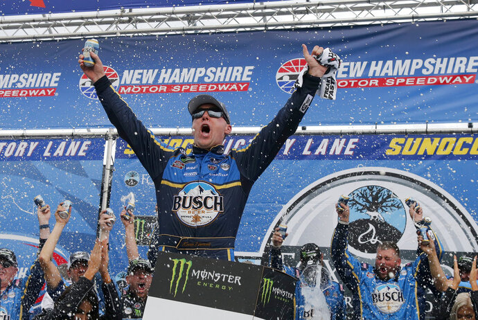 Kevin Harvick celebrates in Victory Lane after winning a NASCAR Cup Series auto race Sunday, July 22, 2018, at New Hampshire Motor Speedway in Loudon, N.H. (AP Photo/Mary Schwalm)