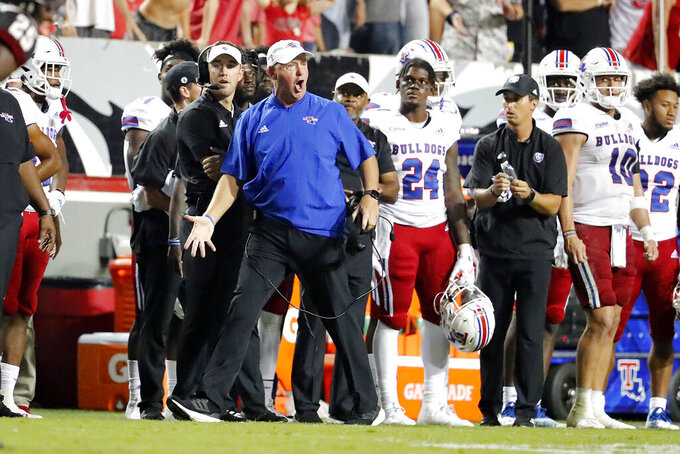Louisiana Tech head coach Skip Holtz protests from the sideline against North Carolina State during the first half of an NCAA college football game in Raleigh, N.C., Saturday, Oct. 2, 2021. (AP Photo/Karl B DeBlaker)