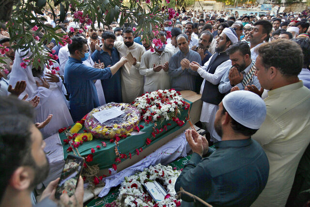People attend the funeral for victims of the crash of a state-run Pakistan International Airlines plane on Friday near the southern port city of Karachi, in Rawalpindi, Pakistan, Monday, May 25, 2020. (AP Photo/Anjum Naveed)