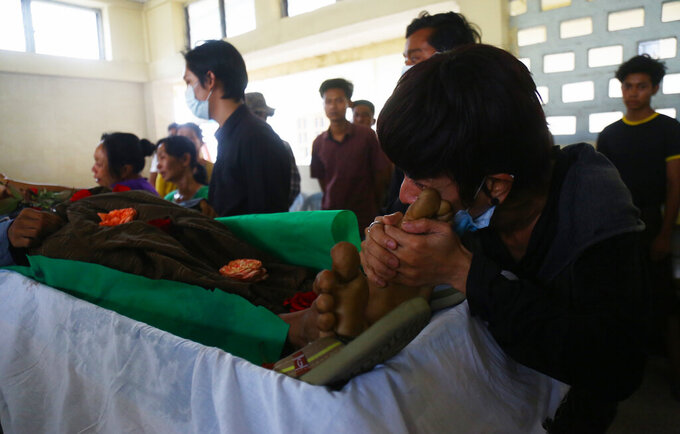 A family member mourns over the death of Aung Myo Thant as they gather at his funeral in Yangon, Myanmar, Tuesday, March 30, 2021. Family members said Aung Myo Thant was killed Monday during a clash with security forces at a protest against the military's coup that ousted the government of Aung San Suu Kyi on Feb. 1. (AP Photo)