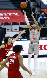 Ohio State guard Duane Washington shoots over Rutgers guard Geo Baker, left, and guard Ron Harper during the second half of an NCAA college basketball game in Columbus, Ohio, Wednesday, Dec. 23, 2020. (AP Photo/Paul Vernon)