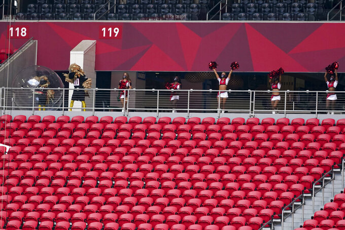 Atlanta Falcons cheerleaders perform in the stands devoid of fans due to the global pandemic COVID-19 during the first half of an NFL football game between the Atlanta Falcons and the Seattle Seahawks, Sunday, Sept. 13, 2020, in Atlanta. (AP Photo/John Bazemore)
