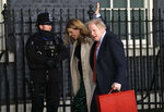 Britain's Prime Minister Boris Johnson and his partner Carrie Symonds arrive back in Downing Street in London, Friday, Dec. 13, 2019. Prime Minister Boris Johnson's Conservative Party has won a solid majority of seats in Britain's Parliament — a decisive outcome to a Brexit-dominated election that should allow Johnson to fulfill his plan to take the U.K. out of the European Union next month. (AP Photo/Matt Dunham)