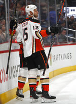Anaheim Ducks center Ryan Getzlaf, front, celebrates his goal with defenseman Cam Fowler during the second period of an NHL hockey game against the Colorado Avalanche on Friday, March 15, 2019, in Denver. (AP Photo/David Zalubowski)