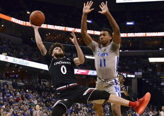 Cincinnati guard Logan Johnson (0) shoots against Memphis guard Antwann Jones (11) in the second half of an NCAA college basketball game Thursday, Feb. 7, 2019, in Memphis, Tenn. (AP Photo/Brandon Dill)
