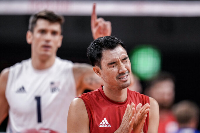 United States' Erik Shoji reacts during the men's volleyball preliminary round pool B match between United States and Russian Olympic Committee at the 2020 Summer Olympics, Monday, July 26, 2021, in Tokyo, Japan. (AP Photo/Manu Fernandez)