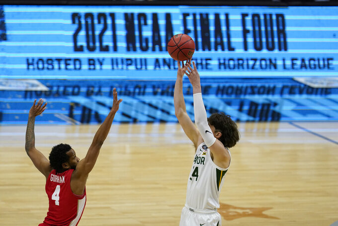 Baylor guard Matthew Mayer (24) shoots over Houston forward Justin Gorham (4) during the first half of a men's Final Four NCAA college basketball tournament semifinal game, Saturday, April 3, 2021, at Lucas Oil Stadium in Indianapolis. (AP Photo/Michael Conroy)