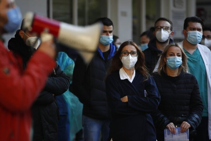 Medical staff gather during a rally to protest over a dispute with Evangelismos state hospital administration in Athens, Wednesday, March 31, 2021. Despite five months of lockdown measures, COVID-19 infections on Tuesday hit a new record in Greece. (AP Photo/Thanassis Stavrakis)