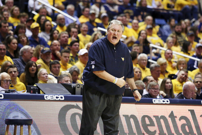 West Virginia Coach Bob Huggins reacts to a call during the first half of an NCAA college basketball game against Texas Tech, Saturday, Jan. 11, 2020, in Morgantown, W.Va. (AP Photo/Kathleen Batten)