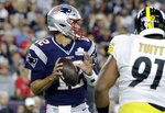 New England Patriots quarterback Tom Brady drops back to pass under pressure from Pittsburgh Steelers defensive end Stephon Tuitt (91) in the first half an NFL football game, Sunday, Sept. 8, 2019, in Foxborough, Mass. (AP Photo/Steven Senne)
