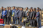 Chinese relatives of a crash victim mourn at the scene where the Ethiopian Airlines Boeing 737 Max 8 crashed shortly after takeoff on Sunday killing all 157 on board, near Bishoftu, south-east of Addis Ababa, in Ethiopia Friday, March 15, 2019. Analysis of the flight recorders has begun in France, the airline said Friday, while in Ethiopia officials started taking DNA samples from victims' family members to assist in identifying remains. (AP Photo/Mulugeta Ayene)