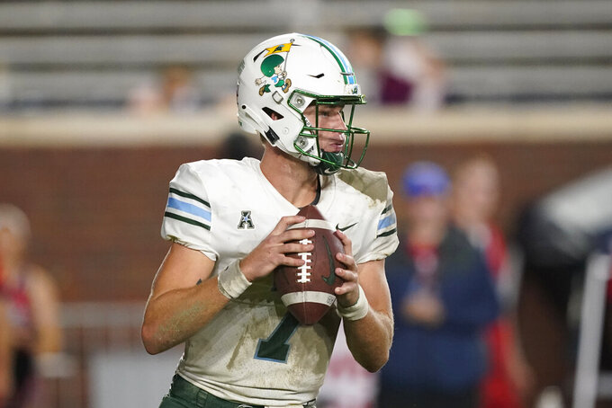 Tulane quarterback Michael Pratt sets up to pass against Mississippi during the second half of an NCAA college football game Saturday, Sept. 18, 2021, in Oxford, Miss. Mississippi won 61-21. (AP Photo/Rogelio V. Solis)