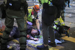 Medical volunteers help an injured man after being attacked by pro-democracy protesters during a crash between protesters and police in Hong Kong, Monday, Nov. 11, 2019. Hong Kong's leader Carrie Lam has pledged to