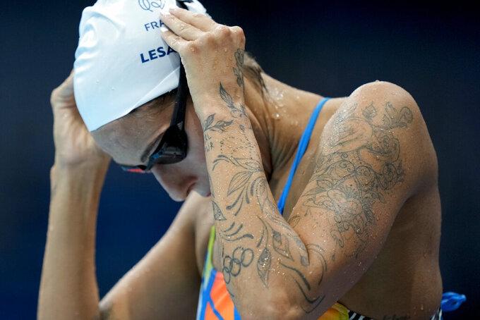 AP PHOTOS: Taboo in Tokyo, tattoos on display at Olympics