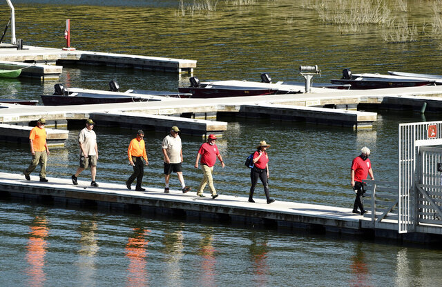 Search and rescue personnel exit the pier at Lake Piru in Los Padres National Forest, Calif., Thursday, July 9, 2020. Authorities said Thursday that they believe