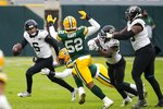 Jacksonville Jaguars' Jake Luton scrambles during the second half of an NFL football game against the Green Bay Packers Sunday, Nov. 15, 2020, in Green Bay, Wis. The Packers won 24-20. (AP Photo/Matt Ludtke)