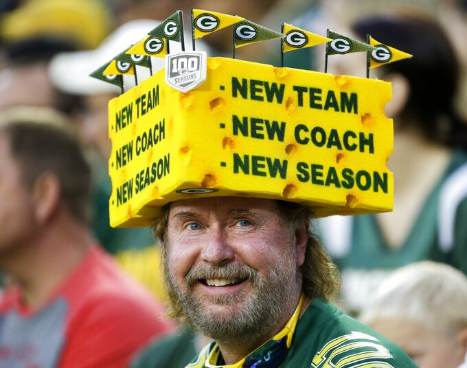 A fan watches during the first half of a preseason NFL football game between the Green Bay Packers and the Kansas City Chiefs Thursday, Aug. 29, 2019, in Green Bay, Wis. (AP Photo/Mike Roemer)