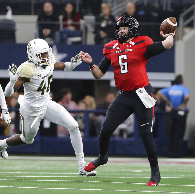 Texas Tech quarterback McLane Carter (6) throws against Baylor defensive end BJ Thompson (48) in the first half  of an NCAA college football game Saturday, Nov. 24, 201 in Arlington, Texas. (Jerry Larson/Waco Tribune-Herald via AP)